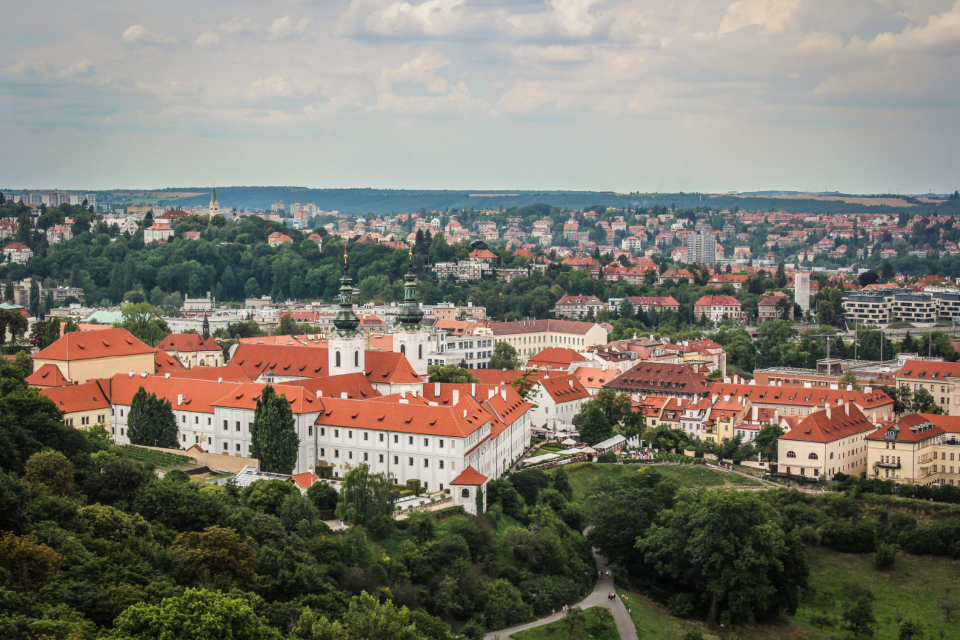 landscape mountain prague europe travel view buildings houses rooftops sky clouds trees nature city architecture