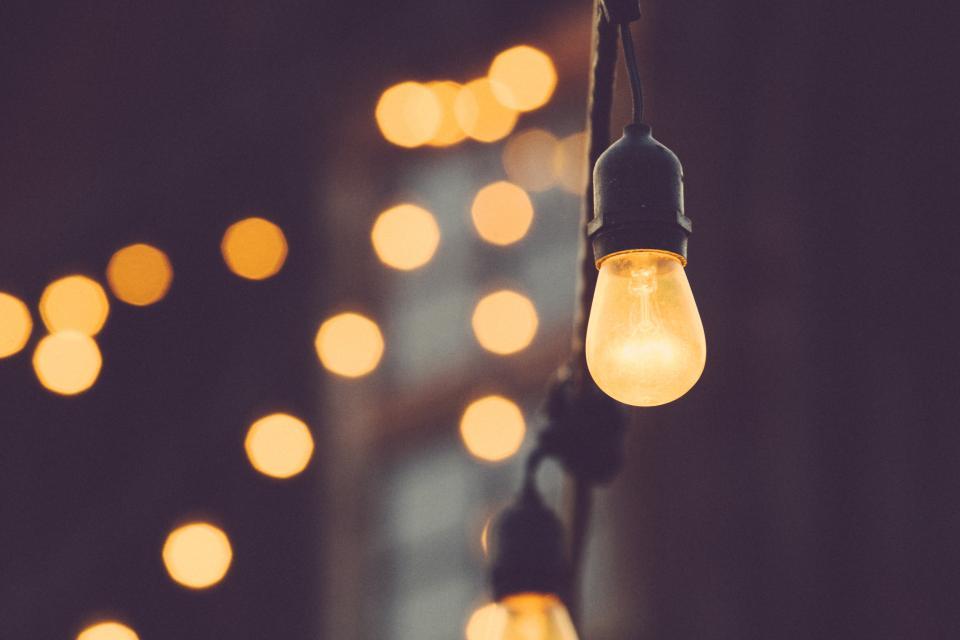 lights string lights light bulbs blurry bokeh abstract idea