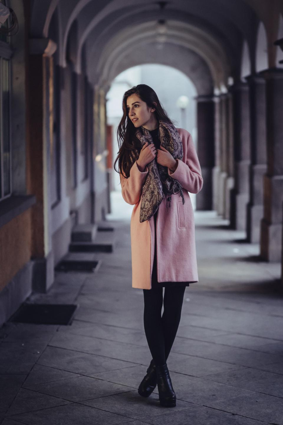 people woman beauty cold weather coat fashion photography photoshoot scarf hallway architecture pillar building establishment