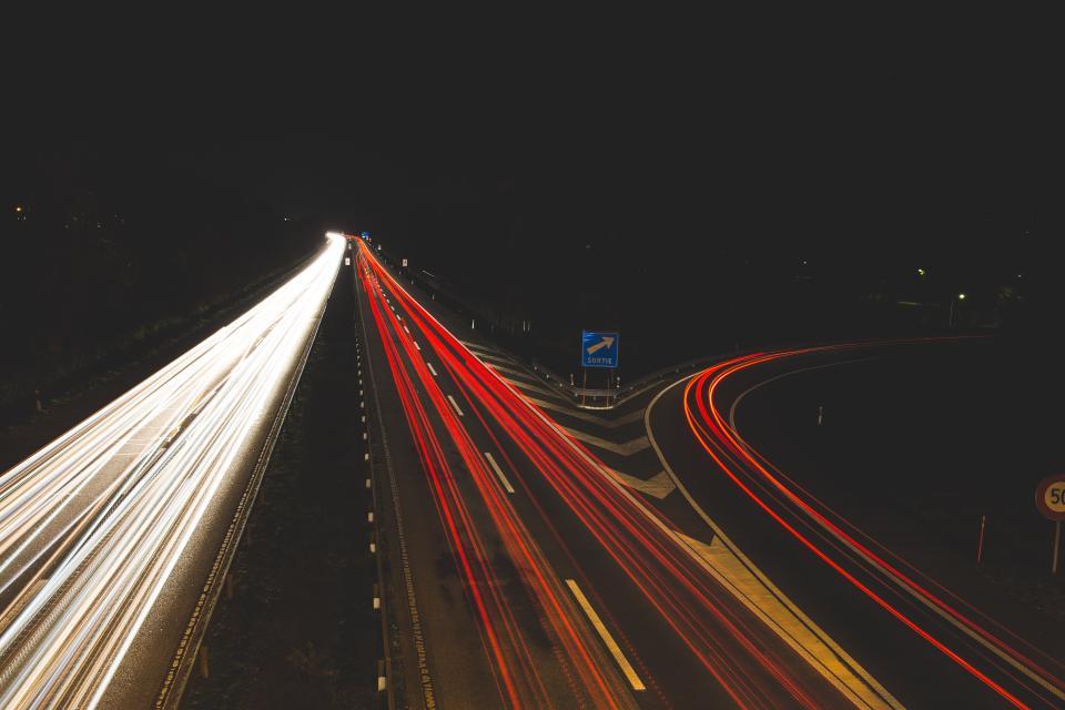 highway road cars lights driving traffic exit dark night evening city urban