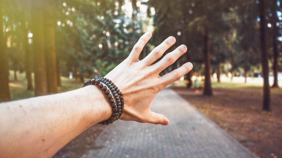 bracelet forest golden yellow green guy hand large outdoors summer sun bright touch trees pov trees forest woods park path sunlight sunshine sun rays grab