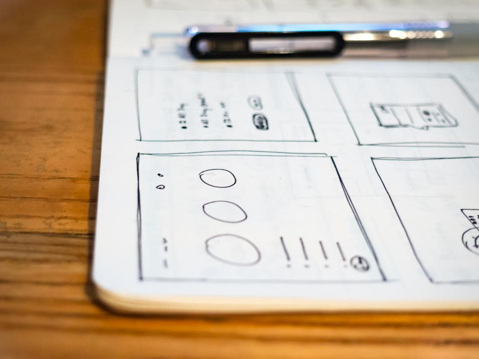office desk business plan work paper notebook pen writing wooden table