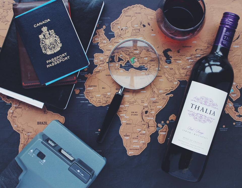 map navigation directions globe travel trip vacation passport magnifying glass polaroid camera wine bottle glass alcohol