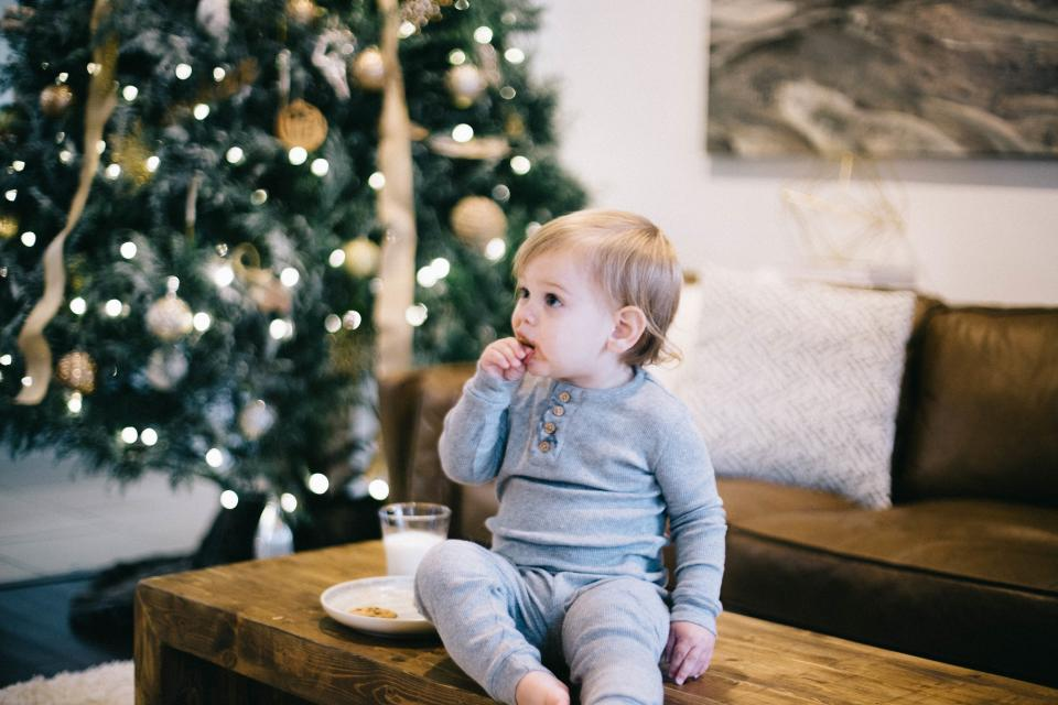 couch, sofa, table, people, kid, child, baby, boy, eat, milk, drink, christmas, tree, light, design, holiday, season, house, interior