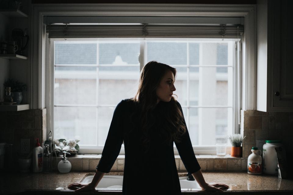 people girl alone house interior inside window