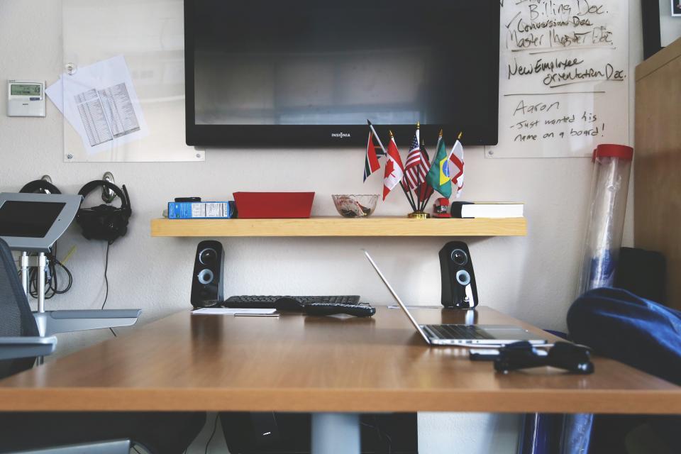desk office business tv television laptop speakers technology