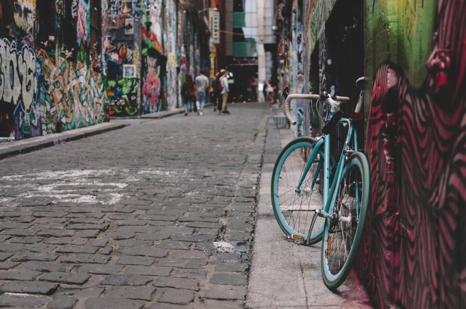 wall art mural painting graffiti public street bike bicycle people men walking