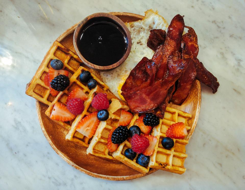 food fried egg blackberry strawberry waffle pancake fruits meat breakfast wooden plate soysauce protein healthy food