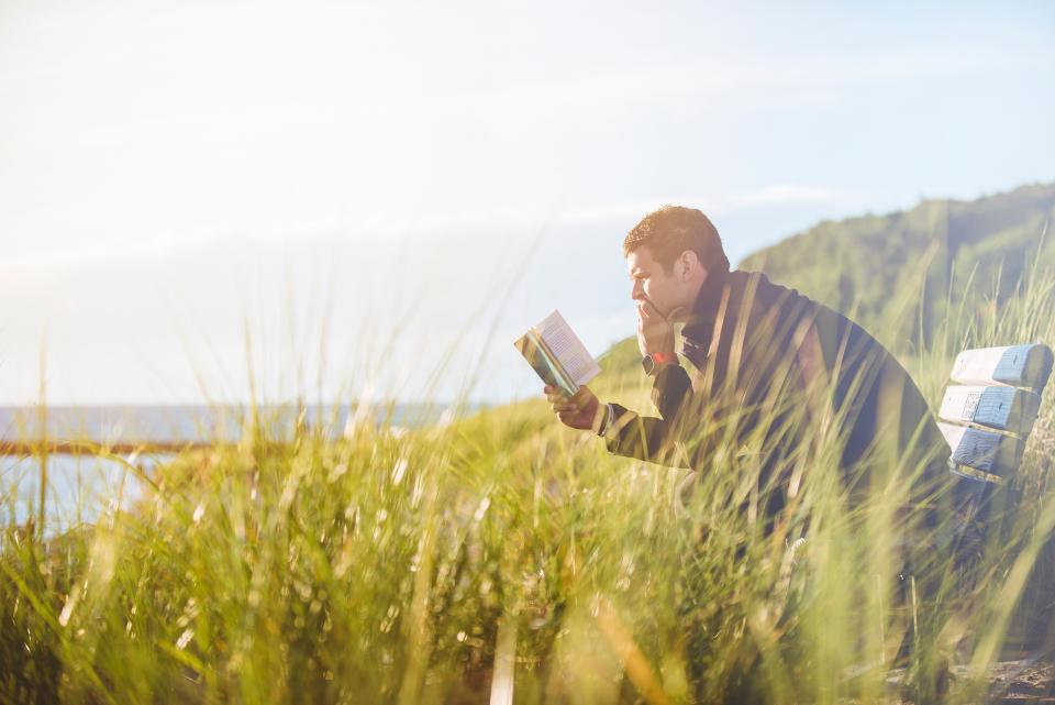 mountain nature sky sunny sunrise summer sunset sunlight sunshine green grass sea water ocean lake man people reading book bible sitting alone bench