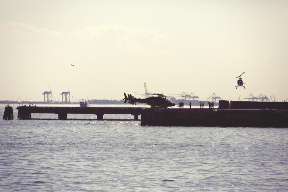 helicopters helipad dock pier water sky