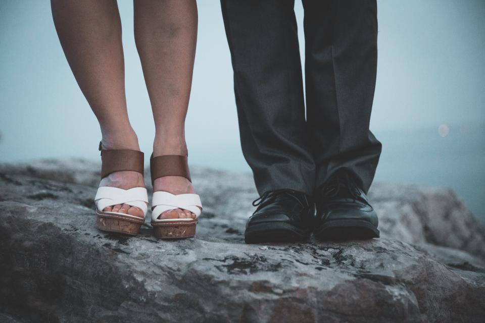 people woman man sandals shoes footwear pants rocks outdoor