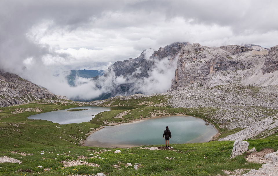 dolomites hiker landscape rock girl italy hiking alps nature mountain travel valley view gardena person summer outdoor looking vacation high clouds male path peak trail traveler backpacker italian beautiful edge