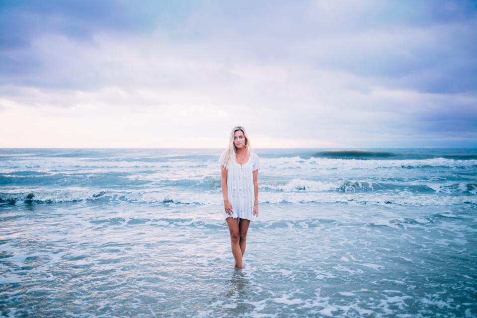 sea woman wave dress fashion model white clouds sky nature blue beach water lady girl