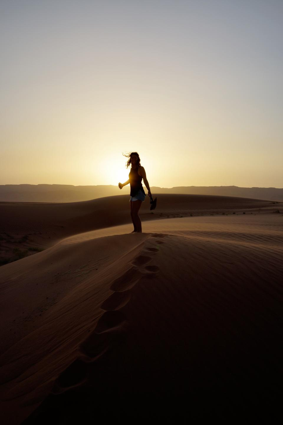 woman, girl, lady, people, stand, desert, dusk, dawn, sunset, sunrise, silhouette, light, shadows, gradient, yellow, brown, black