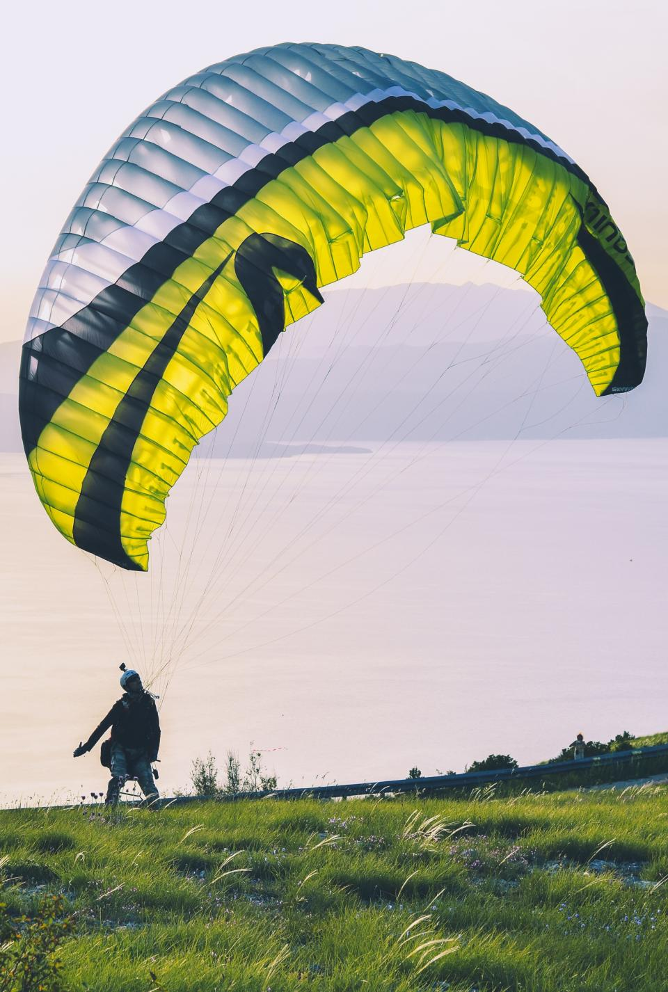 air, sports, paragliding, green, grass, highland, people, man, adventure, outdoor, sky, sunny, day