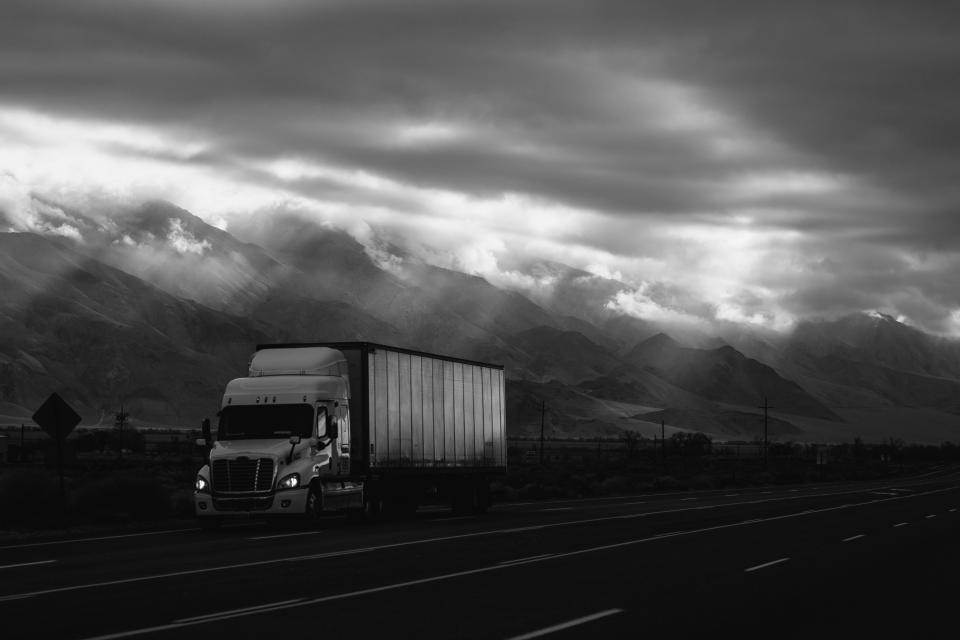 road, truck, van, vehicle, travel, trip, mountain, highland, landscape, sky, clouds, transmission, line