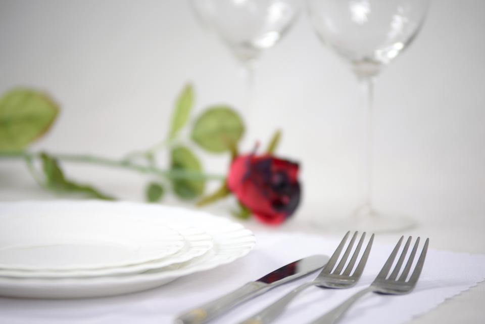 fine dining, dinner, wine, date, candles, romance, sweet, couple, glass, restaurant, rose, red, petals, flowers, fork, knife, plates