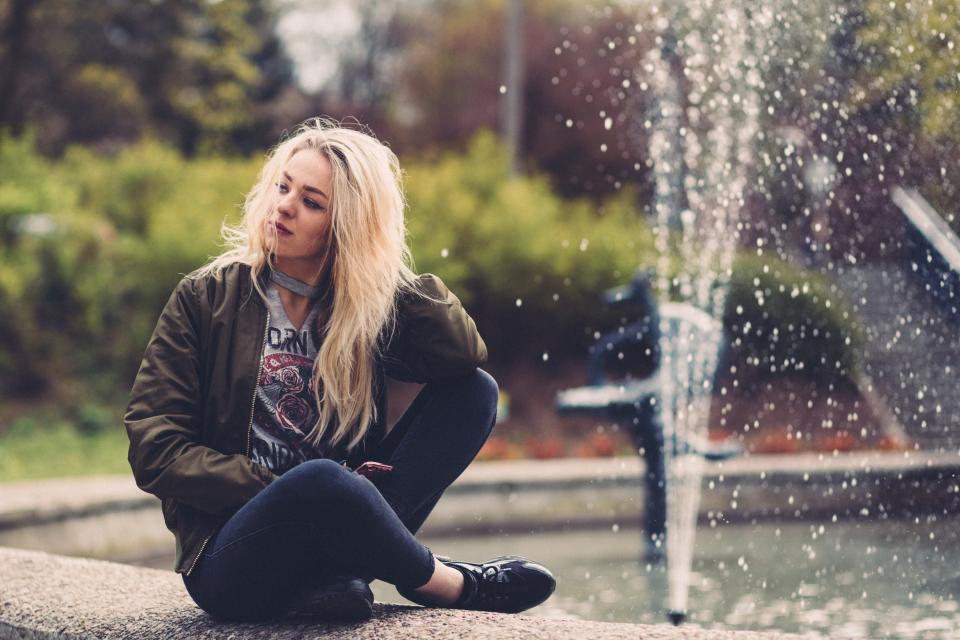 people, girl, woman, sitting, alone, waiting, water, fountain, plaza, trees, plant