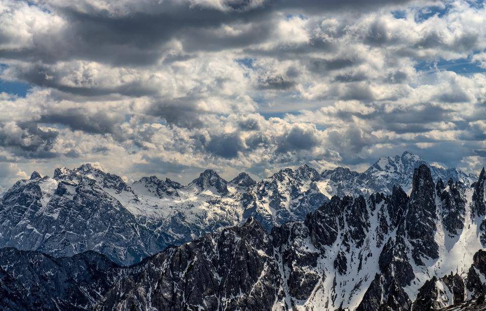 mountain highland clouds sky summit ridge landscape nature valley hill snow winter view travel