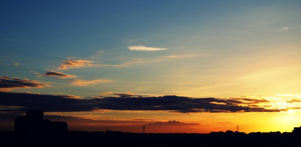 nature landscape silhouette clouds sky grass field travel adventure trek shadow beauty sunset