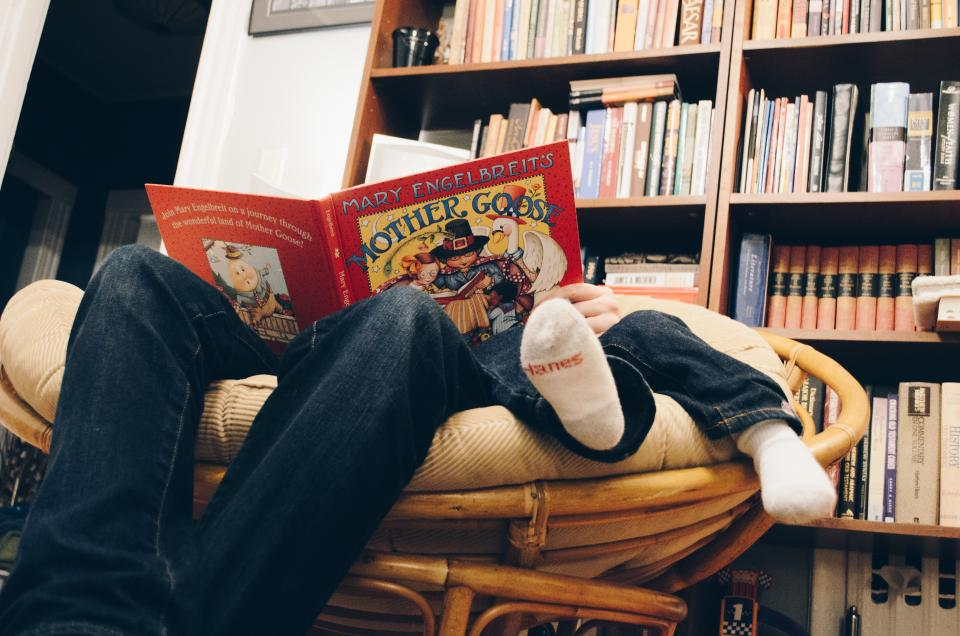books shelf library people father son reading sofa foot sock jeans knowledge study