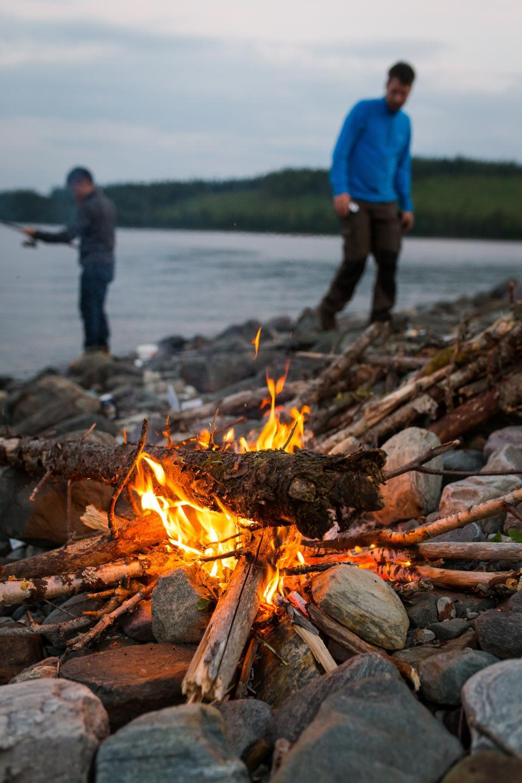 sea, ocean, water, coast, rock, bonfire, flame, light, firewood, wood, camping, people, men, blur
