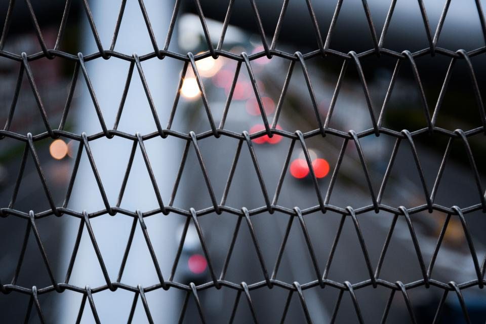 wire fence blur bokeh dark
