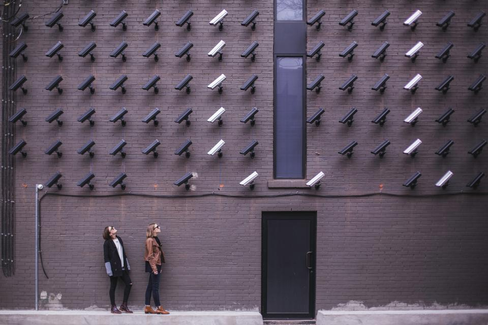 surveillance bricks cameras girls women people city security building technology