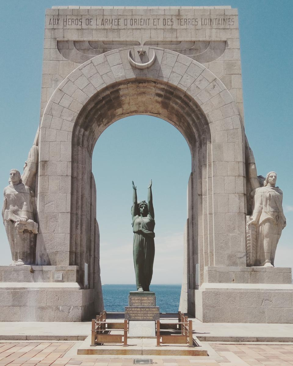 statue, sculpture, monument, gate, arch, landmark, travel, coast, sea, ocean, water, blue, sky