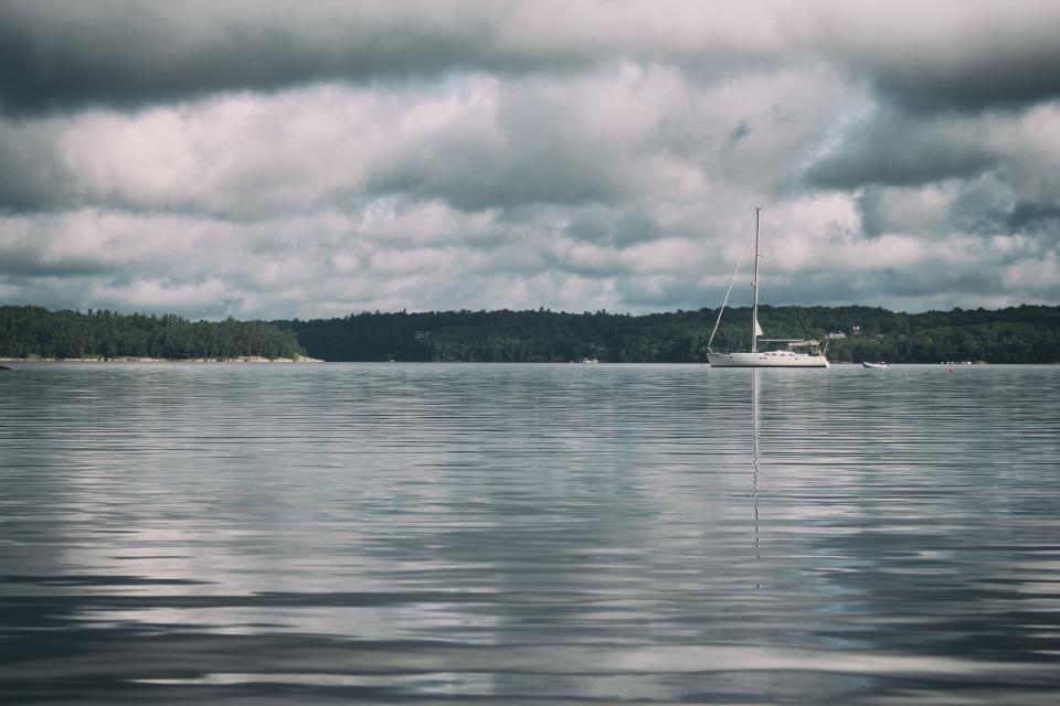 sea, ocean, water, waves, nature, dark, clouds, sky, boat, sailing, fishing, travel, transportation, outdoor, reflection