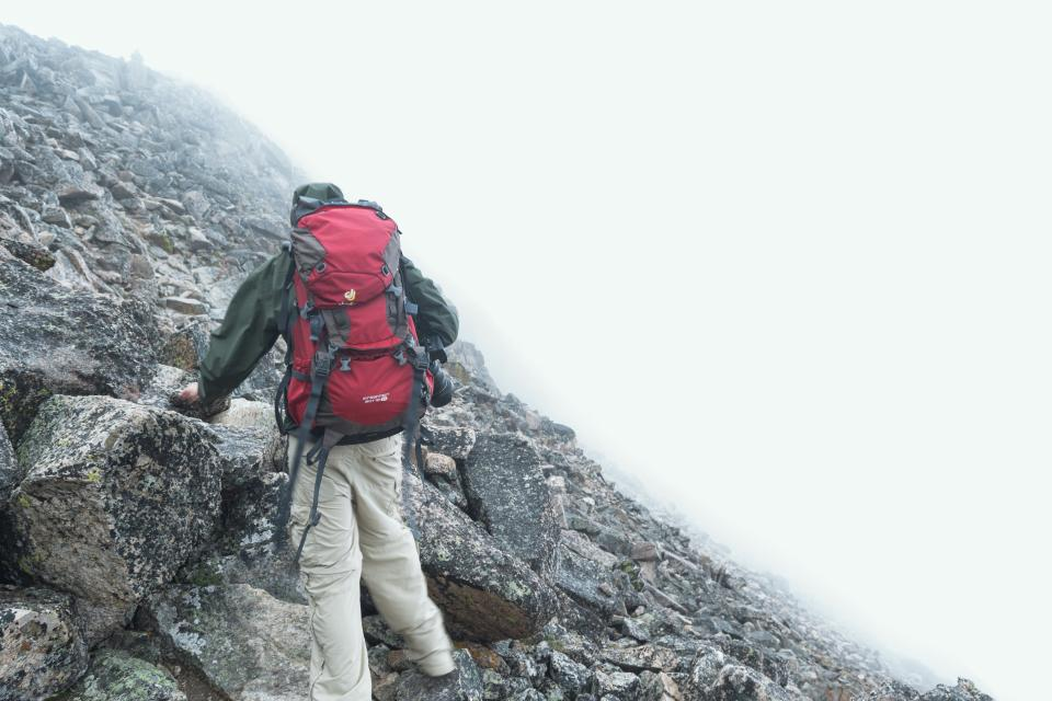 hiking climbing fitness backpack mountain rocks cliff fog foggy guy man people jacket adventure outdoors nature