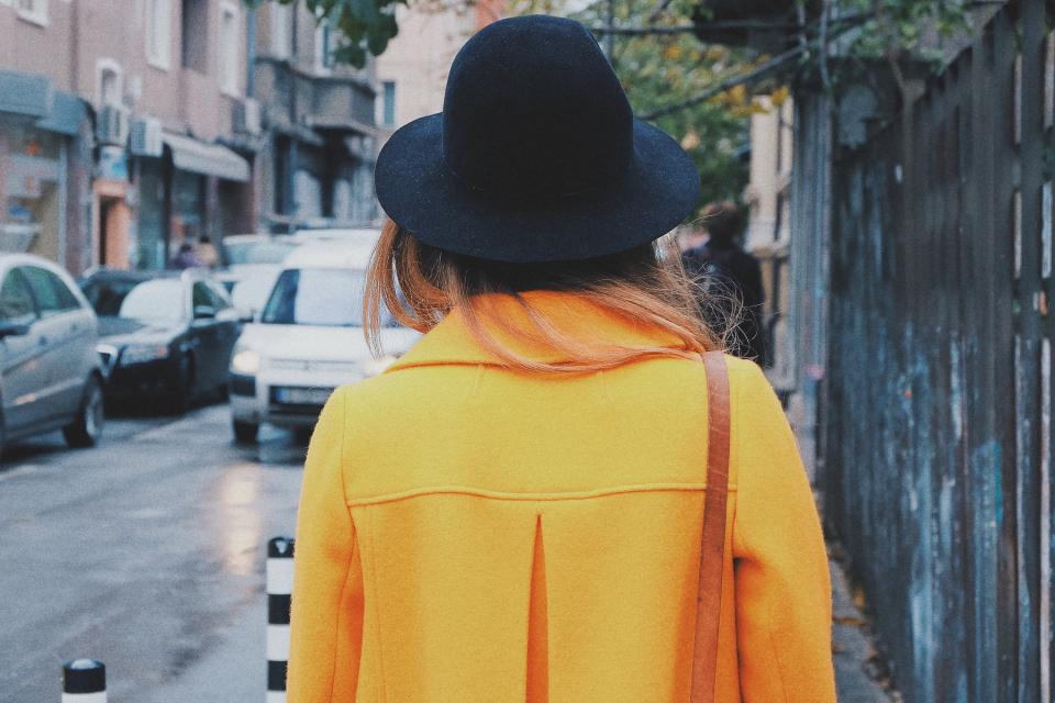 yellow coat hat fashion city streets girl woman pedestrian people cars