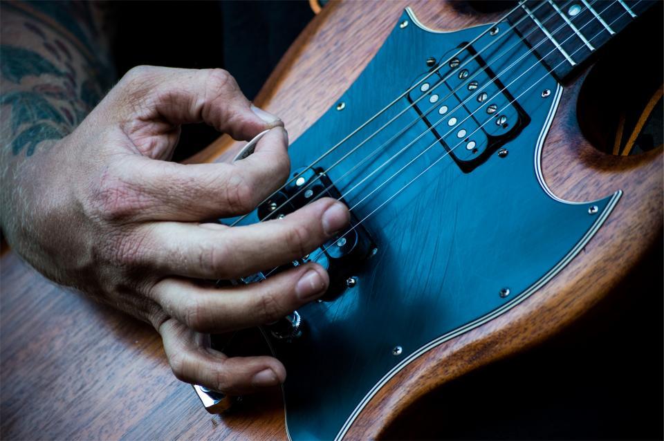 electric guitar musician instrument pick hands music audio
