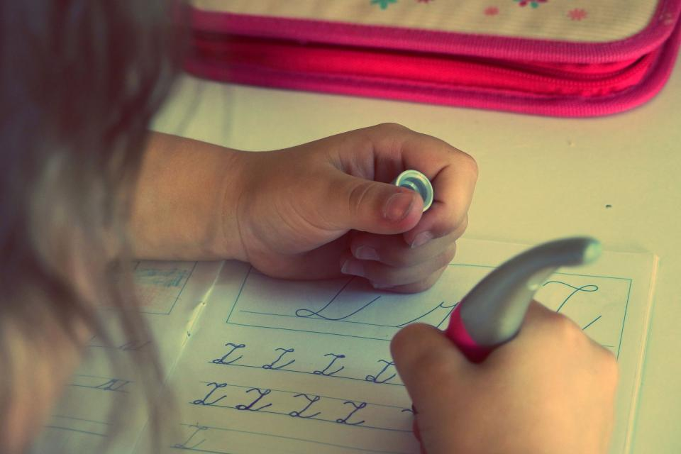 child kid writing homework letters school learning paper pen student class