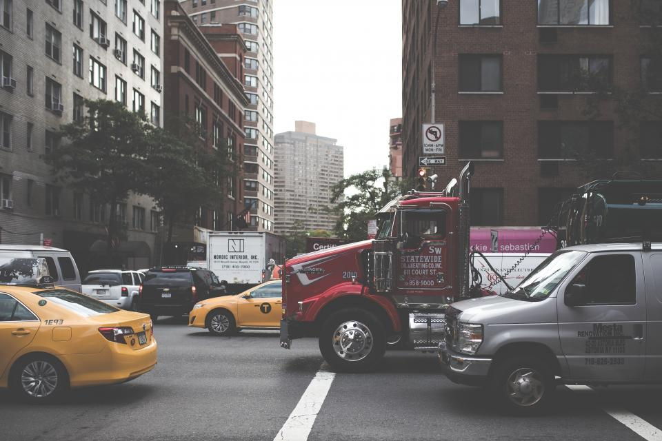 architecture, building, infrastructure, city, street, road, car, truck, taxi, vehicle, transportation, traffic