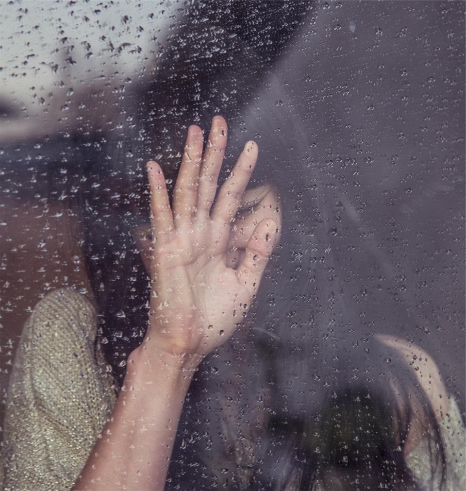 girl sad crying raining rain drops window people woman