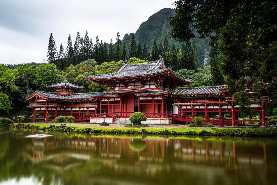 architecture building infrastructure temple green trees plant lake water reflection grass nature travel view mountain landscape