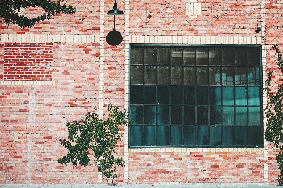 industrial building warehouse windows bricks wall plants