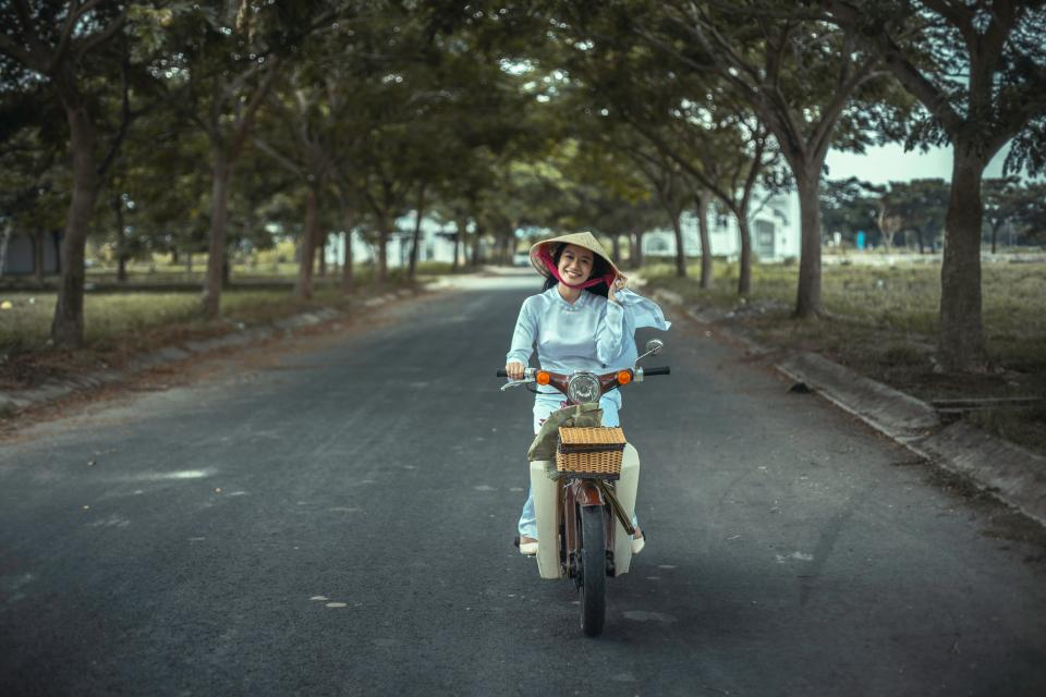 road, path, trees, plant, outdoor, people, woman, girl, driving, motorcycle, smile, happy, travel
