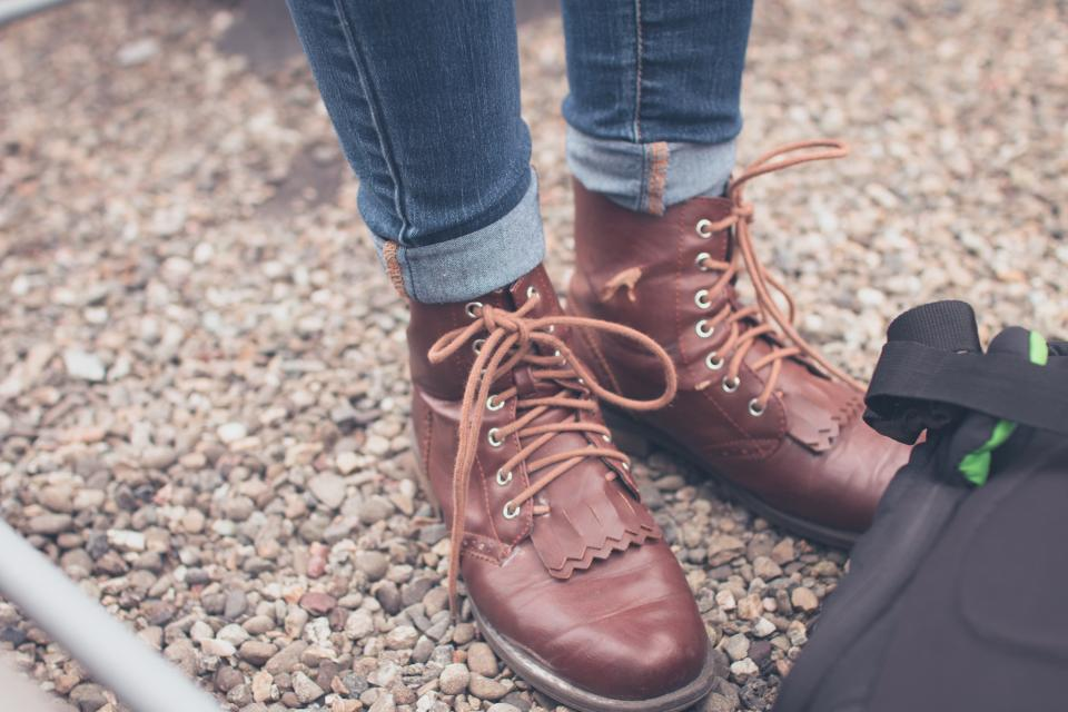 brown leather boots laces shoes fashion ground pebbles
