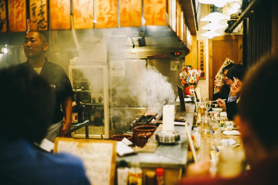 people men guest customer chinese restaurant smoke cooking chef bar eating refrigerator plates glass chopsticks