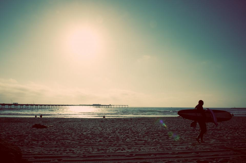 people, man, woman, lady, guy, summer, sun, rays, sand, beach, wave, bridge, surfing, surf board. sky, clouds, outing, travel, outdoor, adventure, sports