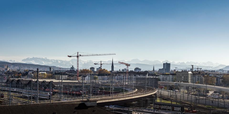 architecture buildings infrastructure blue sky tower crane construction tower bridge road city urban